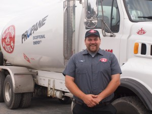 Driver for G.A. Bove Fuels in front of fuel truck